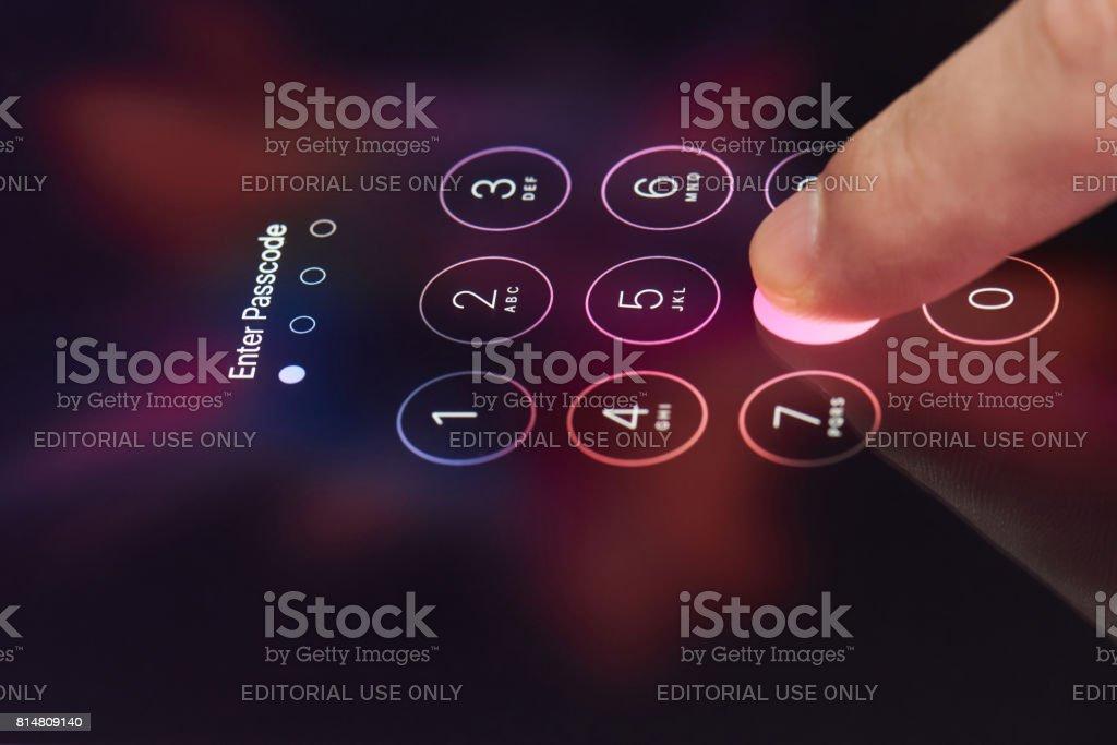 Entering password on smartphone stock photo