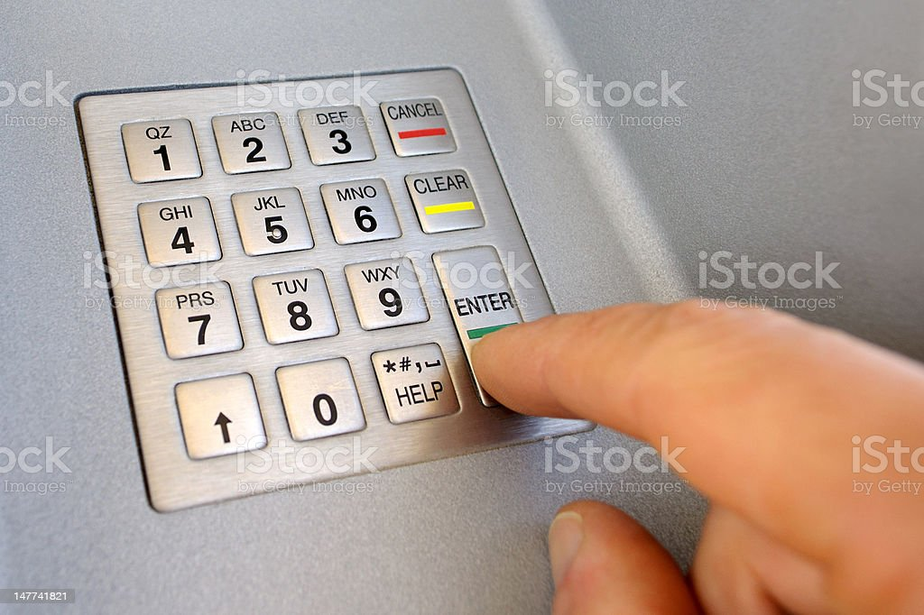 ATM, entering Pin code stock photo
