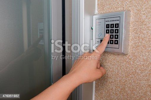 istock Entering security code keypad for opening the onlock door 476351932