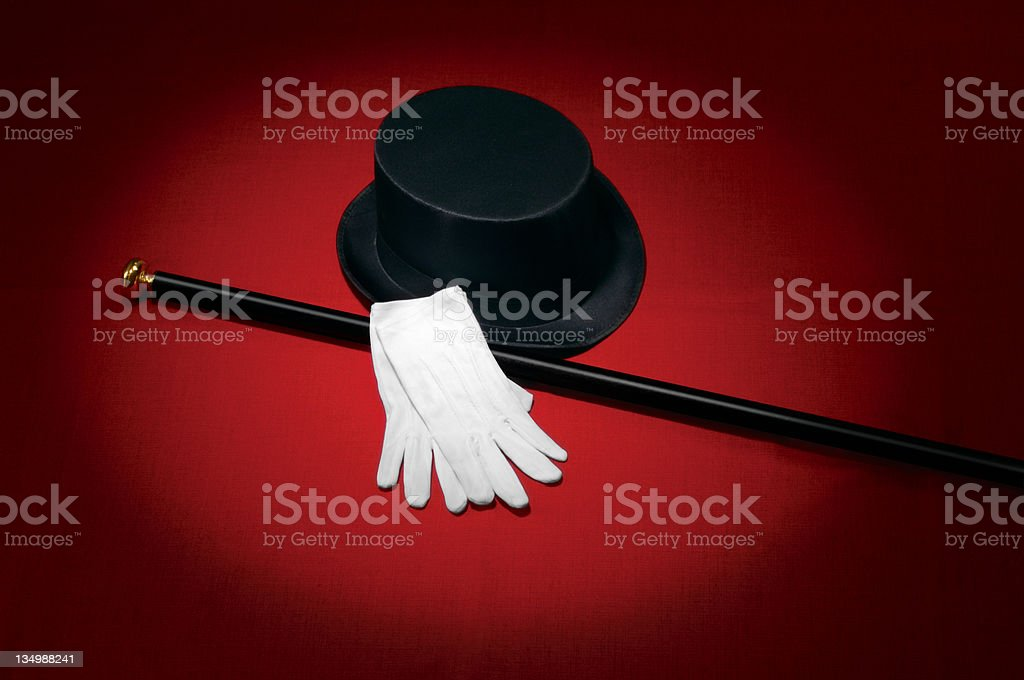 Entertainer's hat, cane, and gloves on a red background stock photo