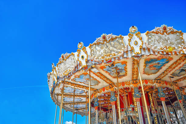 entertainment carousel for the youngest children. horses on a carnival. - karussell stock-fotos und bilder