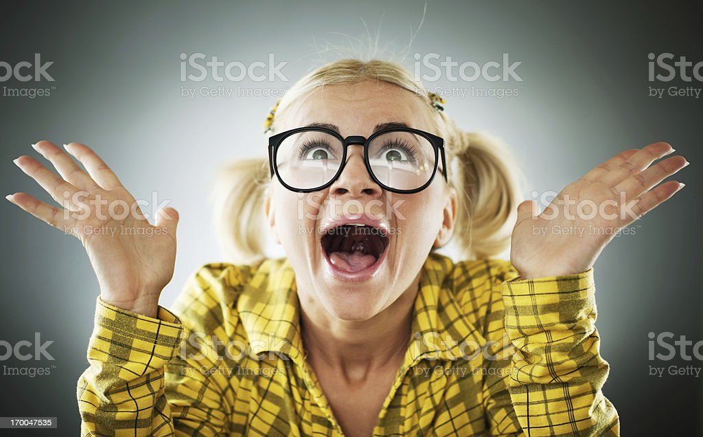 Enthusiastic blonde woman wearing big glasses. stock photo