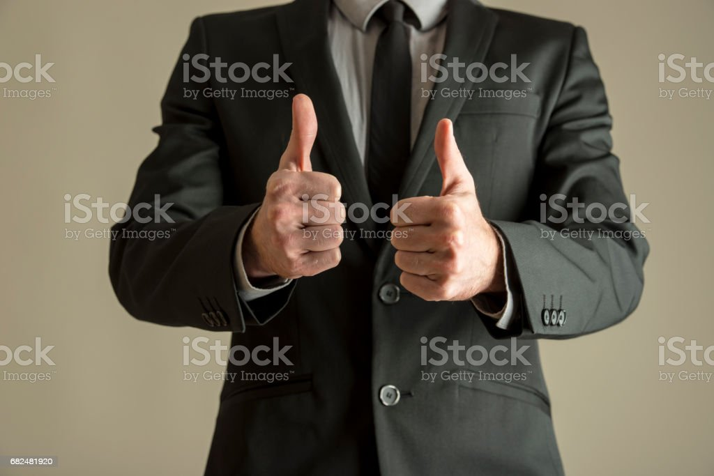 Enthusiastic businessman making a double thumbs up royalty-free stock photo