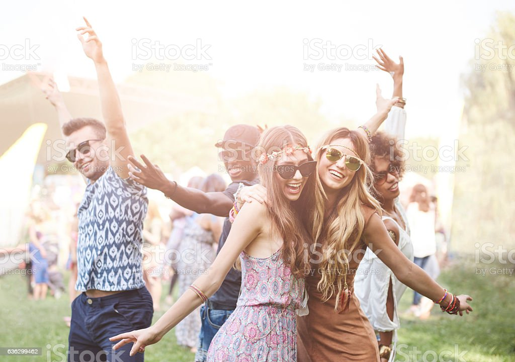 Enthusiastic crowd surfing at music festival stock photo