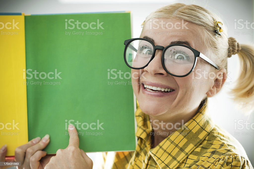 Enthusiastic nerd holding her notebook. royalty-free stock photo