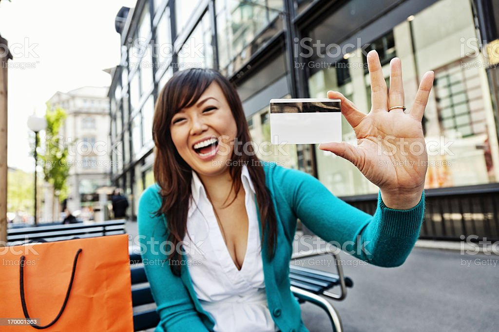 Enthusiastic Young Asian Woman with Credit Card royalty-free stock photo