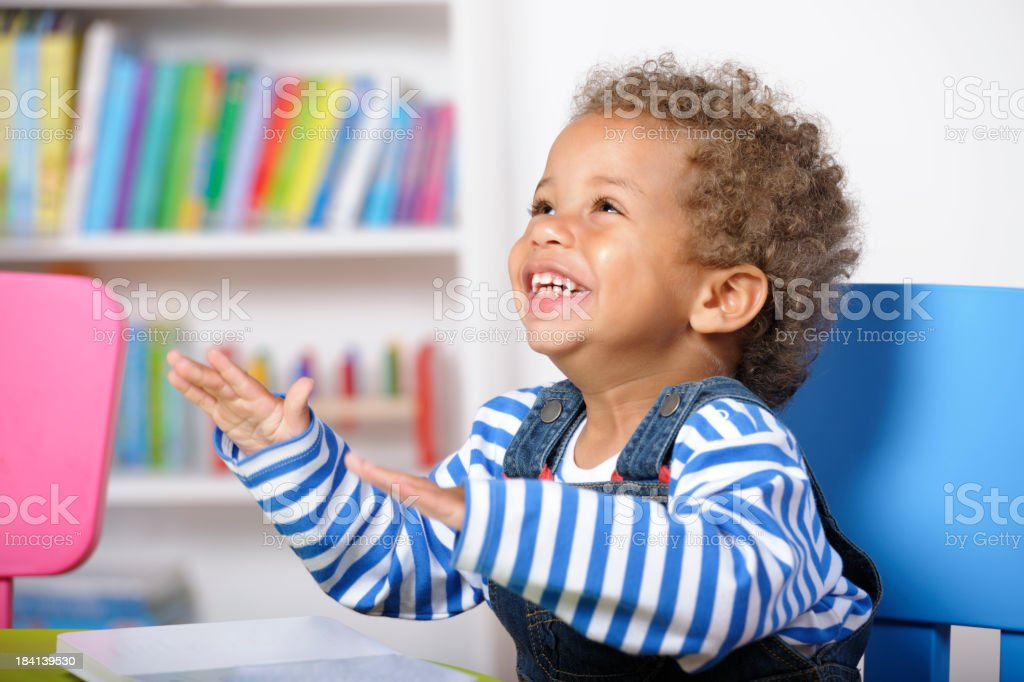 Enthusiatic Baby/ Toddler Showing His Delight During Storytime royalty-free stock photo