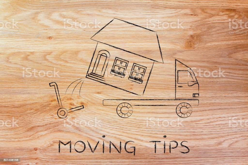 entire house being loaded on truck, moving tips stock photo
