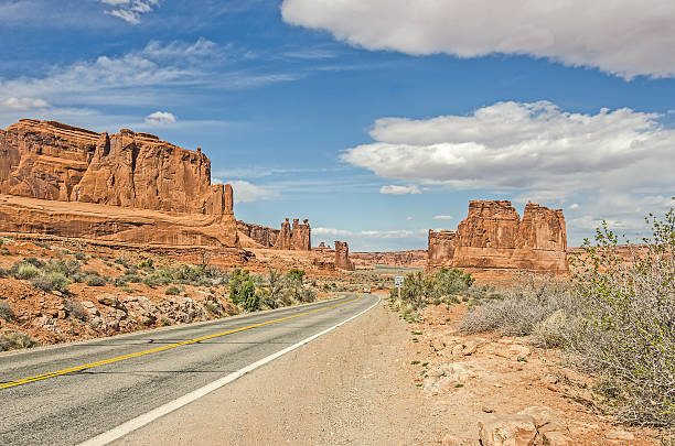 Entrada Sandstone Formations Unique landscape of entrada sandstone formations along a main road in Arches National Park entrada sandstone stock pictures, royalty-free photos & images