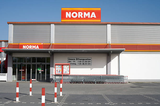 Entrance and logo of Norma supermarket Wiesbaden, Germany - April 10, 2011: Typical entrance of a german Norma supermarket. Norma is a food discount supermarket chain with approximately 1,300 branches in Germany, France and Austria. Founded in 1960 Norma is headquartered in Nuernberg, Germany discount store stock pictures, royalty-free photos & images