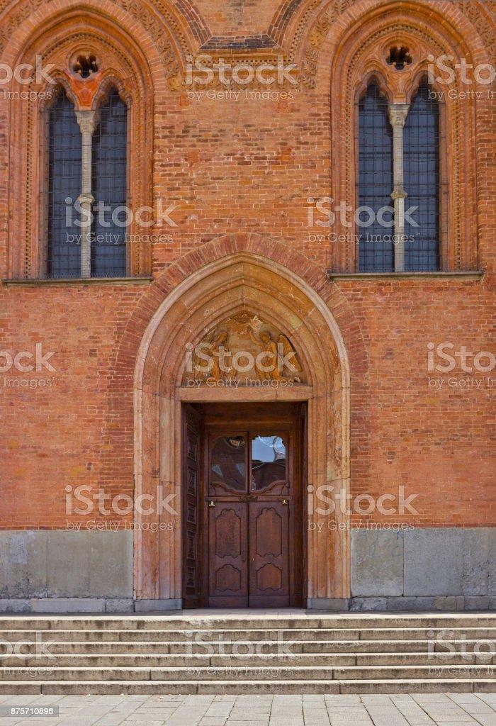 Entrance and windows of church Santa Maria del Carmine in Pavia, Lombardy, northern Italy stock photo