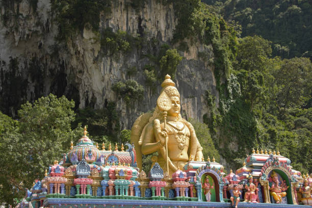 Entrance batu caves Temple decoration and in the background is standing te staue of Lord Murugan. batu caves stock pictures, royalty-free photos & images