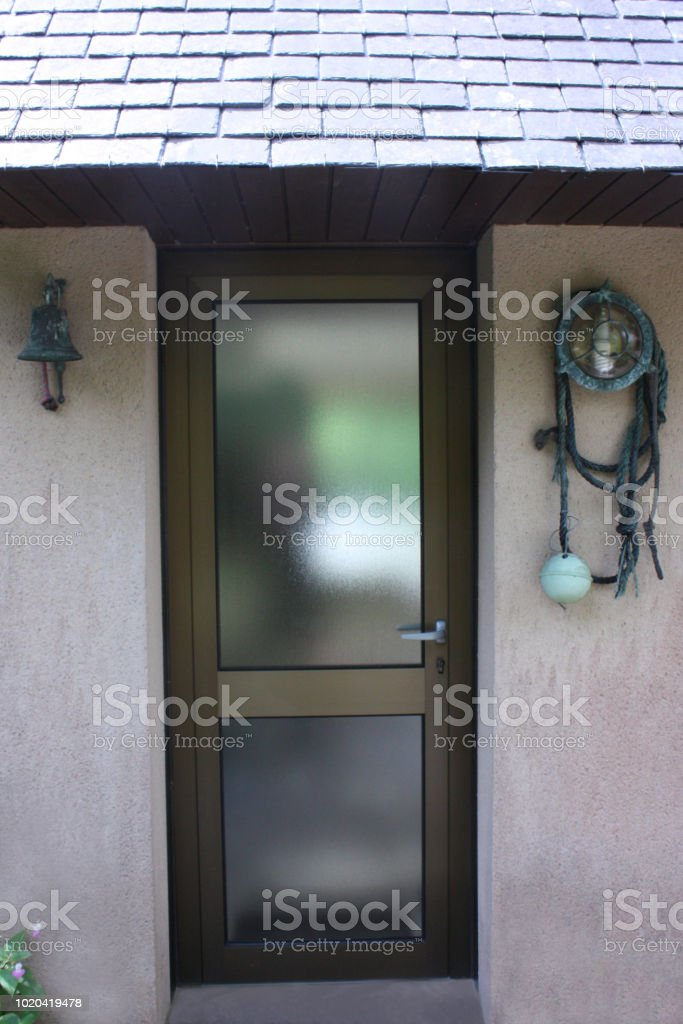 Entrance Door In Tinted Aluminum And Armored Glass Stock Photo