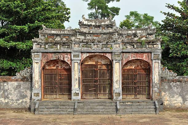 "Entrance door of Khai Dinh Imperial Tomb, Hue ""Entrance door of emperor Khai Dinh Tomb, Hue, Vietnam"" khai dinh tomb stock pictures, royalty-free photos & images"