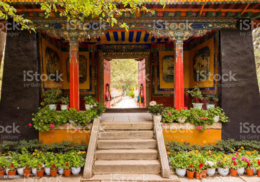 Entrance door to colorful gardens in Norbulinka monastery stock photo