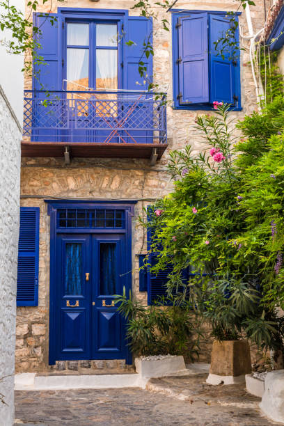 Entrance door with steps. Narrow traditional street in the town of Hydra, Hydra island, Greece stock photo