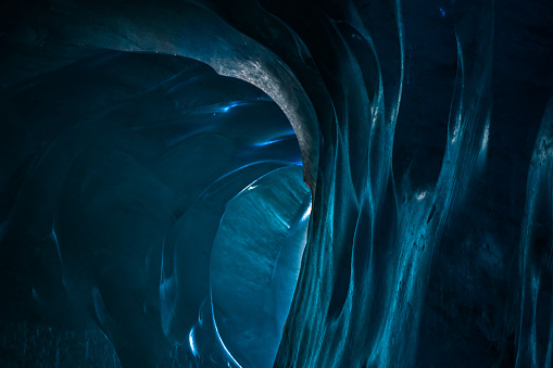istock Entrance exit path of a glacier tunnel with solid ice walls and ceiling. 641593534