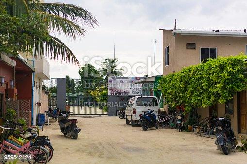Maafushi Island, Maldives – April 13, 2018: Maafushi, Maldives Living quarters with car and motorbikes parked near the entrance of Maafushi Prison on island Maafushi. This is central atoll, Kaafu Atoll in the Maldives and is around 30 km from capital, of Maldives, Malé.