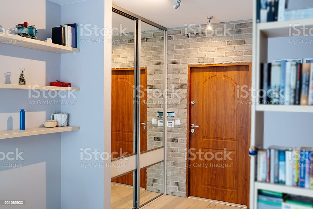 Entrance hall in modern apartment with mirror wardrobe stock photo