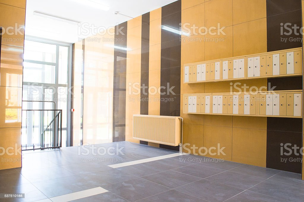 Entrance in modern building with mailboxes stock photo