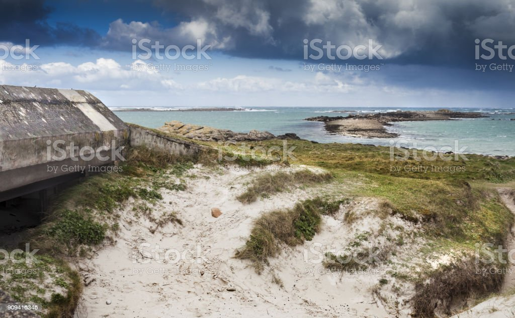 Entrance of a big german bunker with gun part of the Atlantic Wall, Brittany, France. stock photo