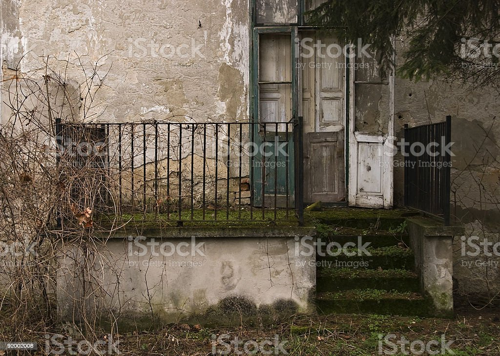 Entrance of an abandoned house royalty-free stock photo