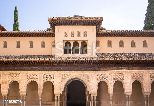Beautiful arches of the entrance in arabic style in courtyard of the Lions in the Alhambra Granada, Andalucia, Spain
