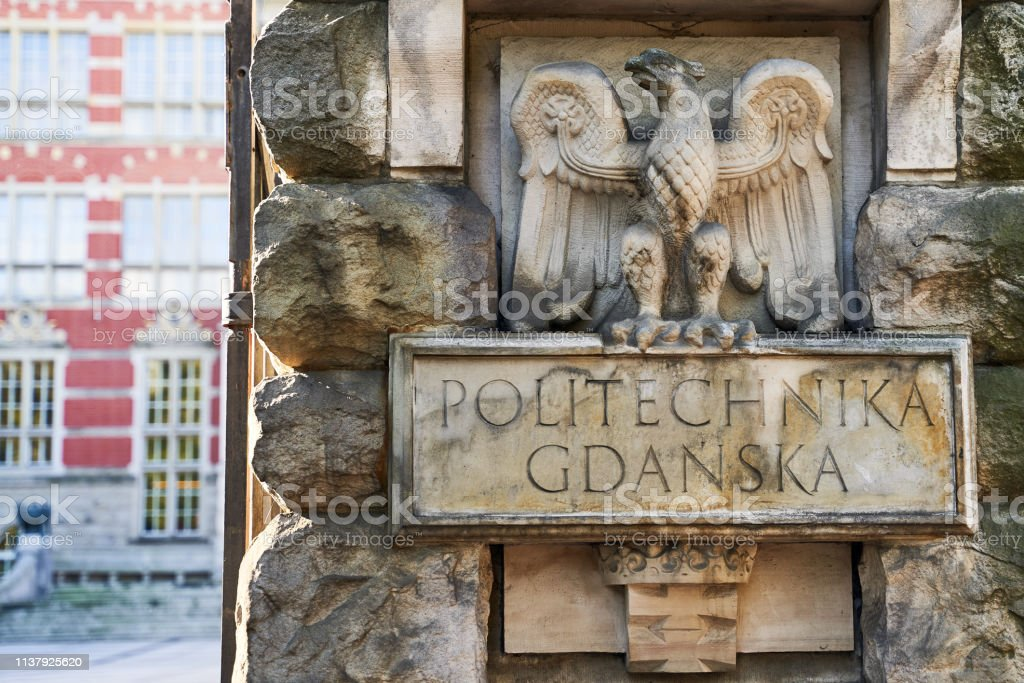 Entrance of Gdansk University of Technology in Poland with words Politechnika Gdanska meaning this higher educational institutiton's name in Polish with the eagle emblem stock photo