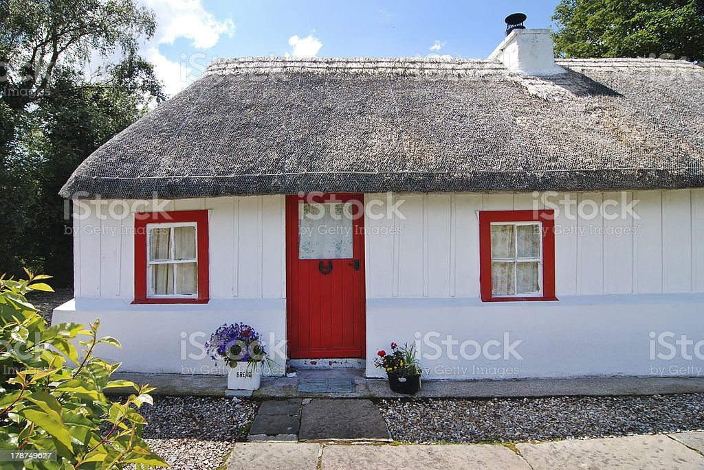 Entrance of Irish cottage with straw thatched roof stock photo