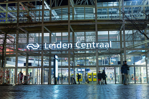 Entrance of Leiden central station Leiden, The Netherlands - December 6, 2016: Entrance of Leiden central railway station with blurred people in motion leiden stock pictures, royalty-free photos & images