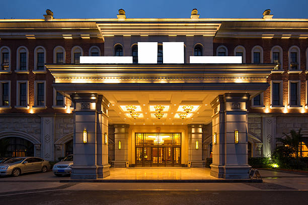 entrance of luxury hotel - entrance stock photos and pictures
