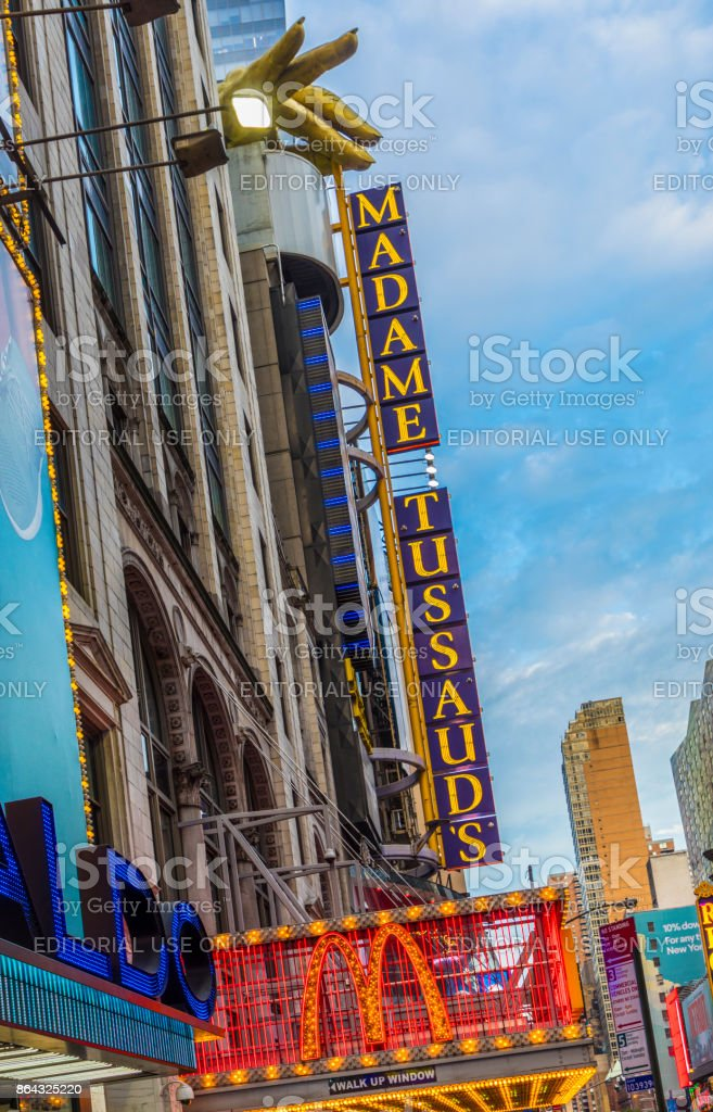 entrance of McDonalds fastfood restaurant and museum madame Tussauds at times square stock photo