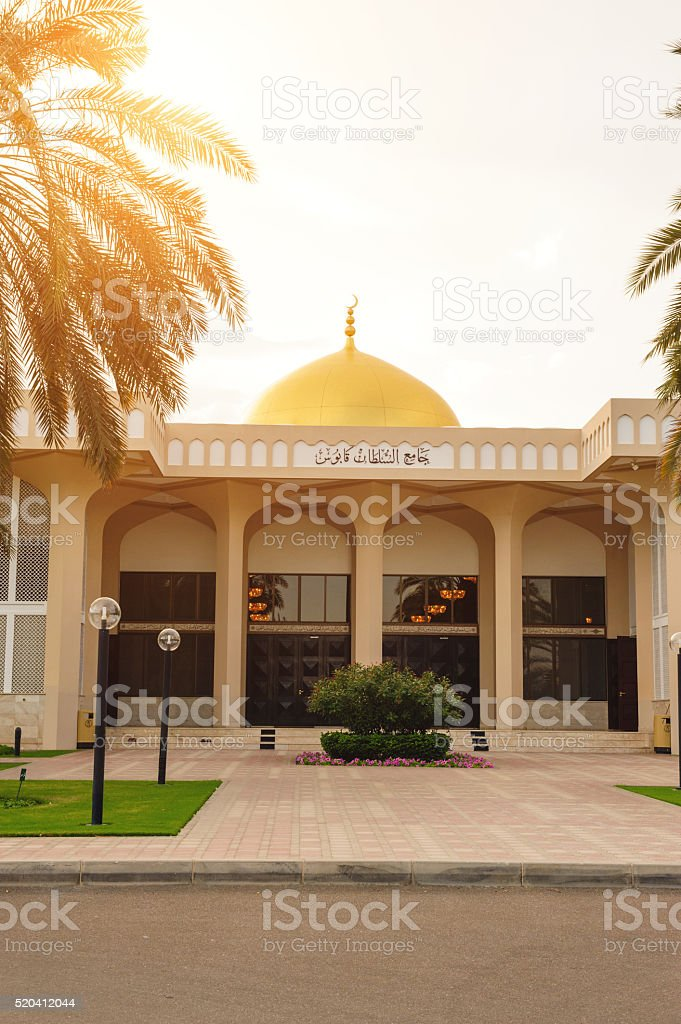 Entrance of Sultan Qaboos Mosque against sunset stock photo