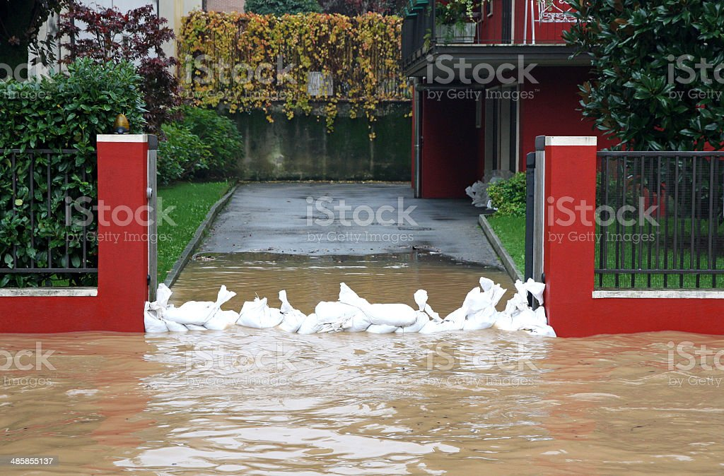 entrance of the House with a bunch of sandbags stock photo
