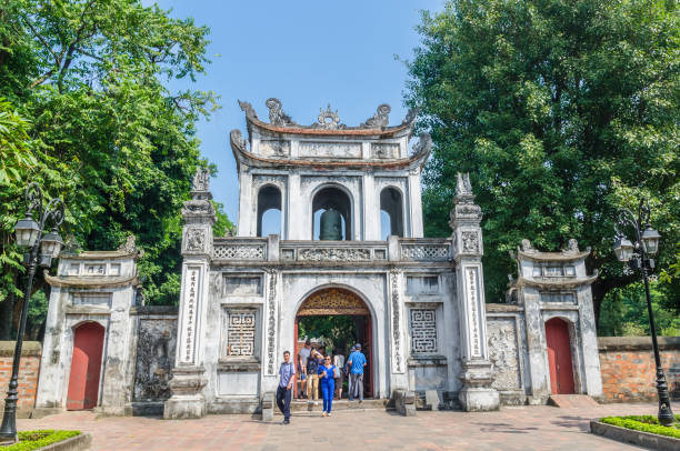 Entrance of the Temple of Literature, it also known as Temple of Confucius in Hanoi. People can seen exploring around it. stock photo