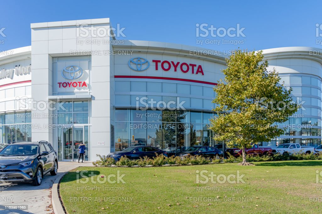 Entrance of Toyota at Don Valley North showroom in Markham, Canada. Markham, Ontario, Canada - October 30, 2018: Entrance of Toyota at Don Valley North showroom, a  New and Used Toyota retailer & Service Centre in Markham, Ontario. Building Exterior Stock Photo