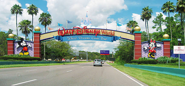 entrance of walt disney world in orlando, florida - orlando florida photos stock photos and pictures