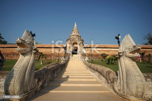 909806032istockphoto Entrance of Wat Phra That Lampang Luang, Thailand 186814565