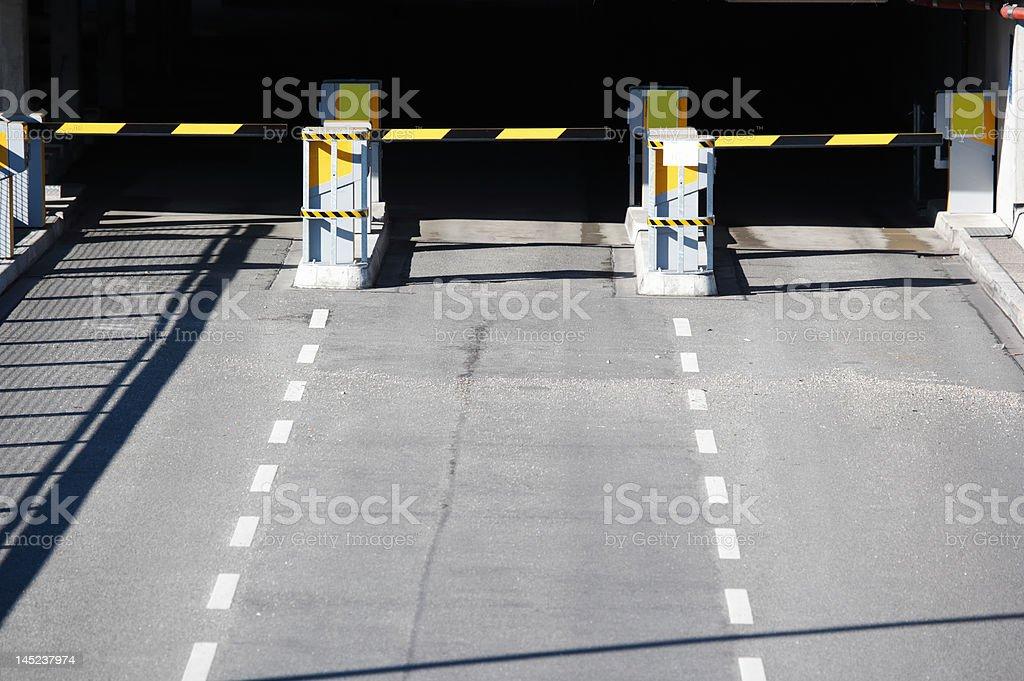 entrance parking garage, three lanes, yellow barrier stock photo