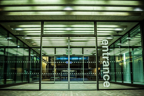 Entrance Glass frontage of a building in the city. entrance sign stock pictures, royalty-free photos & images