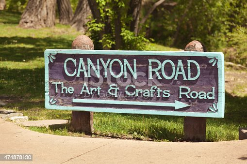 The entrance sign of Canyon Road in Santa Fe, New Mexico, in the American Southwest. A famous district for the southwest style of art and crafts. The several miles long road is filled with art galleries and museums featuring the southwest arts and crafts. Photographed in Santa Fe, New Mexico in horizontal format.