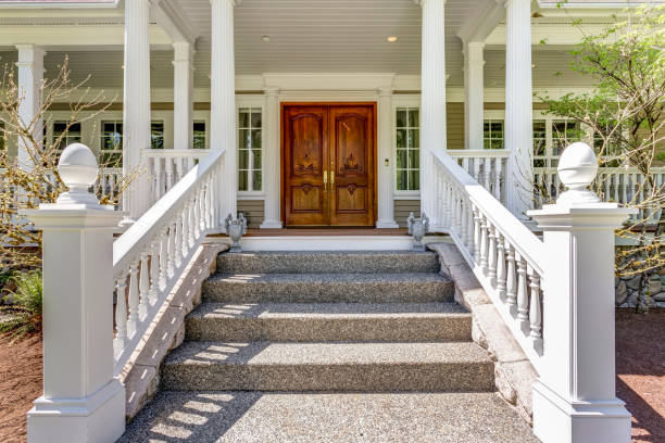 Entrance to a luxury country home with wrap-around deck. stock photo