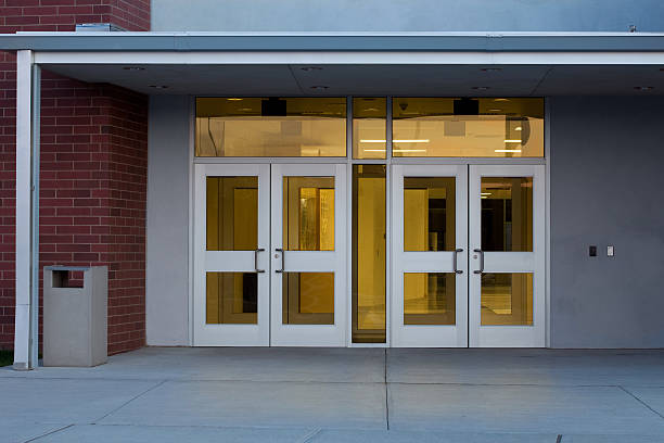 Entrance to a Modern Public School Building with Illuminated Interior stock photo