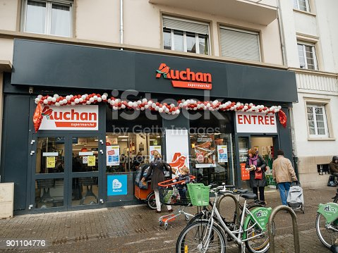 istock Entrance to Auchan French supermarket in city with people 901104776