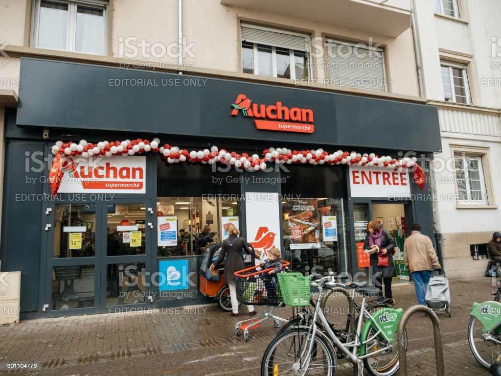 Entrance to Auchan French supermarket in city with people stock photo