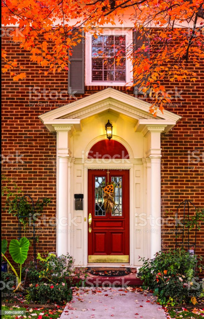 Tremendous Entrance To Brick House With Pillars For Porch And Red Door Download Free Architecture Designs Scobabritishbridgeorg