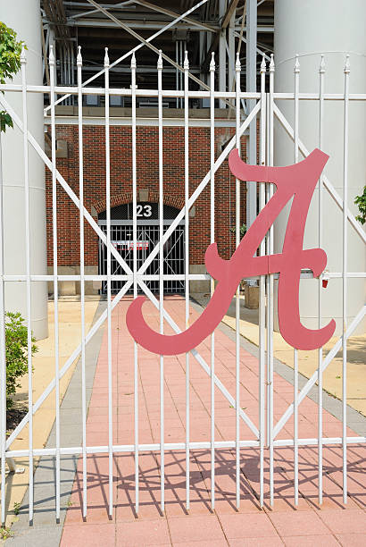 Entrance to Bryant-Denny Stadium with A Sign stock photo