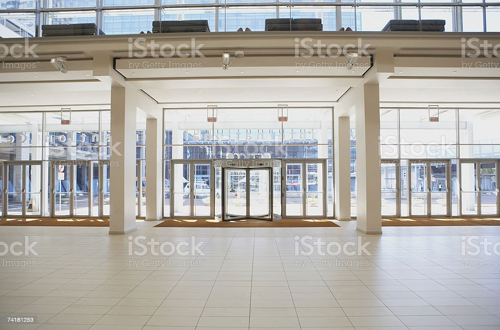 Entrance to building with light and large windows stock photo