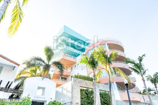 South Beach, USA - May 5, 2018: Entrance to colorful the Beach House hotel in Miami, Florida in Art Deco district with nobody during sunny day, palm trees