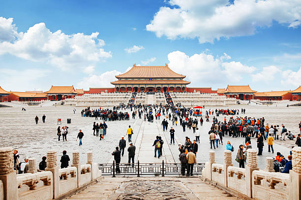 Entrance to Forbidden City in Beijing, China Entrance to the forbidden city in Beijing, China. Lot's of tourists meeting in front of the temple. forbidden city stock pictures, royalty-free photos & images